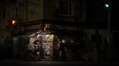 Corner convenience store exterior at night Stock Footage