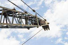 Old Crane or Metal Structure and Sling on Blue Sky Background Stock Photos
