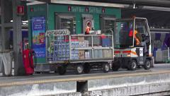 Luggage and stock transportation vehicle delivers goods to train station shop Stock Footage