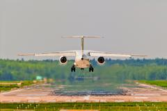Rear view of an aircraft departing from the airport - stock photo