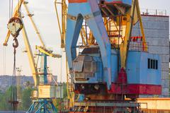 Crane for loading containers at the port Stock Photos