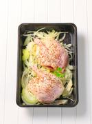 Raw duck legs with caraway and onion in a baking pan - stock photo