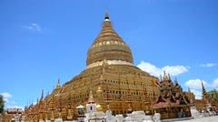 Traveller and Burmese people come to Shwezigon Pagoda at Bagan in Myanmar Stock Footage
