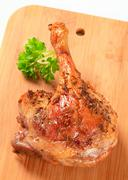 Roast duck leg topped with caraway seeds - stock photo