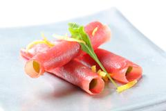 Thin slices of raw beef - rolled up - stock photo
