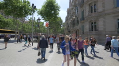 Young tourists walking near Casa Batllo in Barcelona Stock Footage
