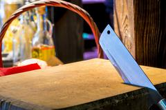 Sharp knife jumper is placed in a wooden cutting board Stock Photos