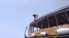 Young Fit Man Jumps Backflip Off The Boat Stock Footage