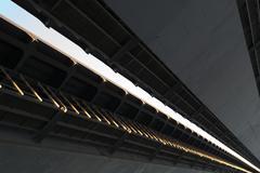 Closeup detail of a metal road bridge Stock Photos