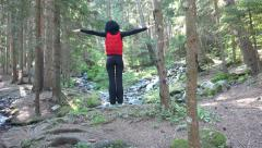 Girl exercise in deep forest near snow melting springs. UHD 4K steadycam stoc Stock Footage