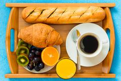 Continental breakfast on a tray from above a close-up shot Stock Photos