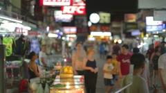 Rack focus - evening on khaosan road Stock Footage