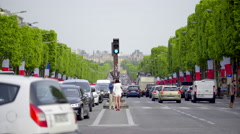 Many cars and people at Champs-Élysées street Stock Footage