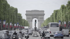 Many cars in front of Arch of Triumph in Paris Stock Footage