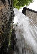 abundant fresh water jet of a waterfall - stock photo