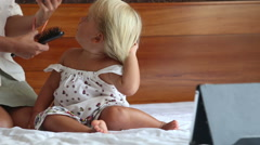 small girl sits close to tablet mother explains safe distance - stock footage