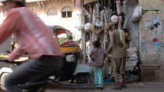 Rope salesman in a Porbandar side street Stock Footage