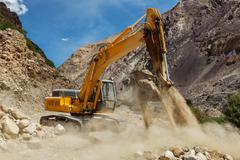 Road construction in Himalayas - stock photo