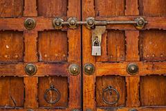 Latch with padlock on door - stock photo