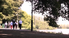 Young teenagers sailors after school walking in park2 Stock Footage