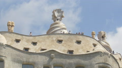 Tourists on the rooftop of Casa Mila, Barcelona Stock Footage