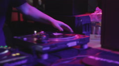 Closeup of deejay hand scratching vinyl record on sound deck Stock Footage