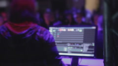 Stock Video Footage of Disk jockey performing set for nightclub guests, using software