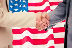 Composite image of close up of people shaking hands Stock Illustration