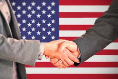 Composite image of two people having a handshake in an office - stock illustration
