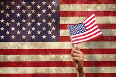 Composite image of hand waving american flag Piirros