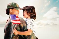 Stock Photo of Composite image of solider reunited with son