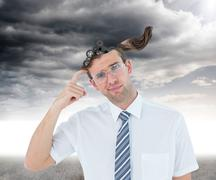 Composite image of geeky businessman thinking with finger on temple - stock illustration