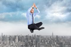 Stock Illustration of Composite image of calm businessman sitting in lotus pose with hands together