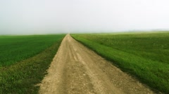 Country road with massive fog, aerial footage - stock footage