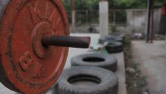 Old Weightlifting Bench & Tires in Thai Gym Hand Held Stock Footage