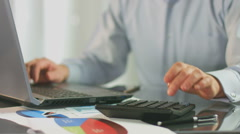 Bookkeeper inserting  data in file on laptop, phone call - stock footage