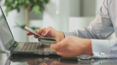 Man inserting credit card number on mobile phone, online banking Stock Footage