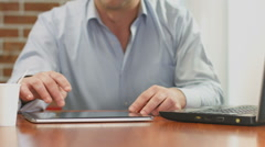 Man browsing internet pages on ipad, reading news feed online - stock footage