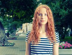 Ginger haired women feeling unhappy and looking at camera Stock Photos