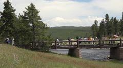 Yellowstone tourism Midway Geyser Basin Bridge pan 4K Stock Footage