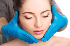 female face with beauty treatment - stock photo