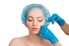 woman receiving  botox injection - stock photo