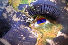 woman's face with planet Earth texture and armenian flag inside the eye. - stock photo