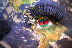 Woman's face with planet Earth texture and azerbaijani flag inside the eye. Stock Photos