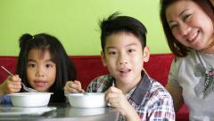 Asian child eating an ice creme in relax time . Stock Footage