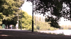 Young teenagers sailors after school walking in park Stock Footage