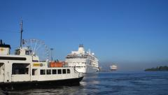 A ferry passing the  Silver Whisper in Helsinki harbour. Wide Stock Footage