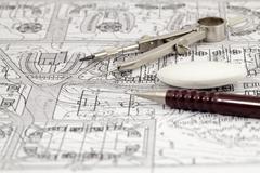 architecture blueprint & work tools - pencil, compass, eraser - stock photo
