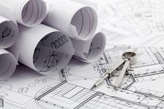 Rolls of architecture blueprint & compass Stock Photos
