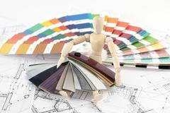 Wooden man, a palette of colors designs for interior works, samples of plasti Stock Photos